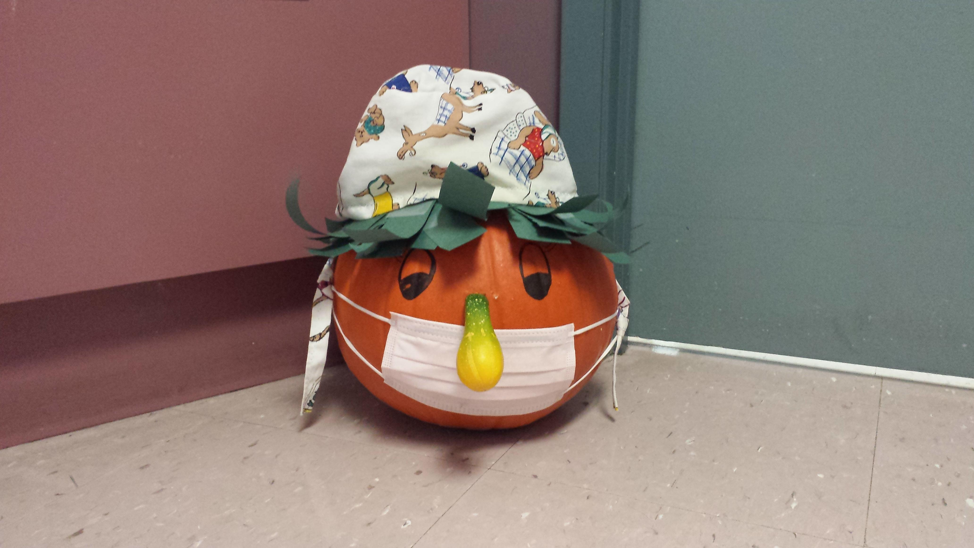funny pumpkin in a hat